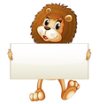 A young lion holding an empty banner vector image vector image