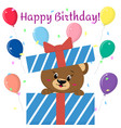 brown bear peeks out of the gift box on the vector image vector image