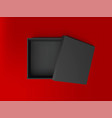 black open empty squares cardboard box on red vector image vector image