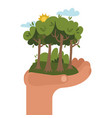 human hand holding green tree forest with bushes vector image