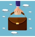 Hand holding briefcase flat style vector image vector image