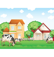 Three cows eating in front of the neighborhood vector image vector image