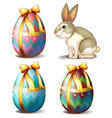 Three colorful eggs and a cute bunny vector image vector image