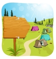 blank wooden board standing near campsite vector image vector image