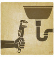 plumber with wrench repairing leaking pipe vector image