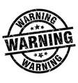 warning round grunge black stamp vector image vector image