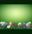 Decorated easter eggs in a green grass background