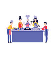 chef cooking food with team at kitchen table flat vector image vector image