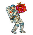 cosmonaut with gift box vector image vector image