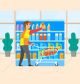 man in grocery store with cart shopping vector image vector image