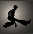 silhouette of guy wearing wide trousers dancing vector image vector image