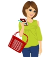 attractive woman holding shopping basket vector image vector image