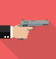 Hand holding handgun vector image vector image