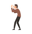 scared and terrified man doing stop gesture vector image vector image