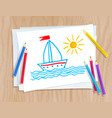 color pencils lying on paper with child drawing vector image