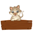 A cat with an empty wooden board vector image vector image