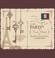 vintage postcard with eiffel tower and old keys vector image
