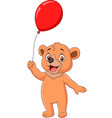 cartoon little bear holding a red balloon vector image vector image