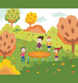cartoon children jumping on a trampoline in autumn vector image