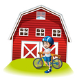 A boy with a bike standing in front of the vector image vector image