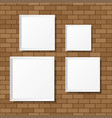 Blank white posters on the brick wall blank vector image