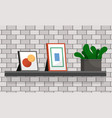 photo frame and cactus in pot on shelf decoration vector image