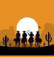 cowboys silhouette riding horses at sunset desert vector image