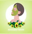 young woman applying avocado fresh fruit face mask