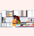 couple embracing and kissing at kitchen counter vector image vector image