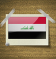 Flags Iraq at frame on a brick background vector image