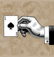 hand with the ace of spades playing card on the vector image