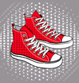 Red sports shoes decorated with stars