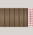 checkered tablecloth on a wooden background vector image