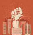 raised up giant arm fist above red cityscape vector image vector image