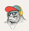 gorilla listening music in headphones vector image vector image