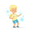 cute little blonde boy playing bubbles vector image vector image