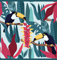 tropical leaves seamless pattern with toucan vector image