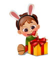 a little happy animated boy unwraps a gift on vector image
