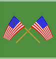 two crossed american flags on green background vector image vector image