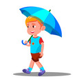 little boy walks with an open blue umbrella in his vector image vector image