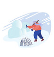 Happy young woman playing snowballs fight on snowy