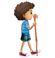A young boy hiking vector image vector image