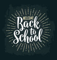 welcome back to school lettering with rays vector image