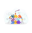 tiny people assemble a puzzle vector image vector image
