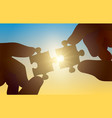 hands hold a puzzle on a sunny background vector image vector image