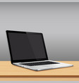 laptop blank screen on wooden table with grey wall vector image vector image