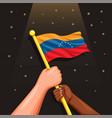 venezuela national flag in hand symbol vector image vector image