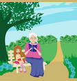 grandmother and granddaughter in the garden vector image