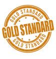 gold standard grunge rubber stamp vector image vector image