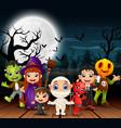 happy halloween kids wearing costume in the night vector image vector image